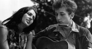 Joan Baez and Bob Dylan perform at a civil rights rally in Washington, 1963. Pic: Getty
